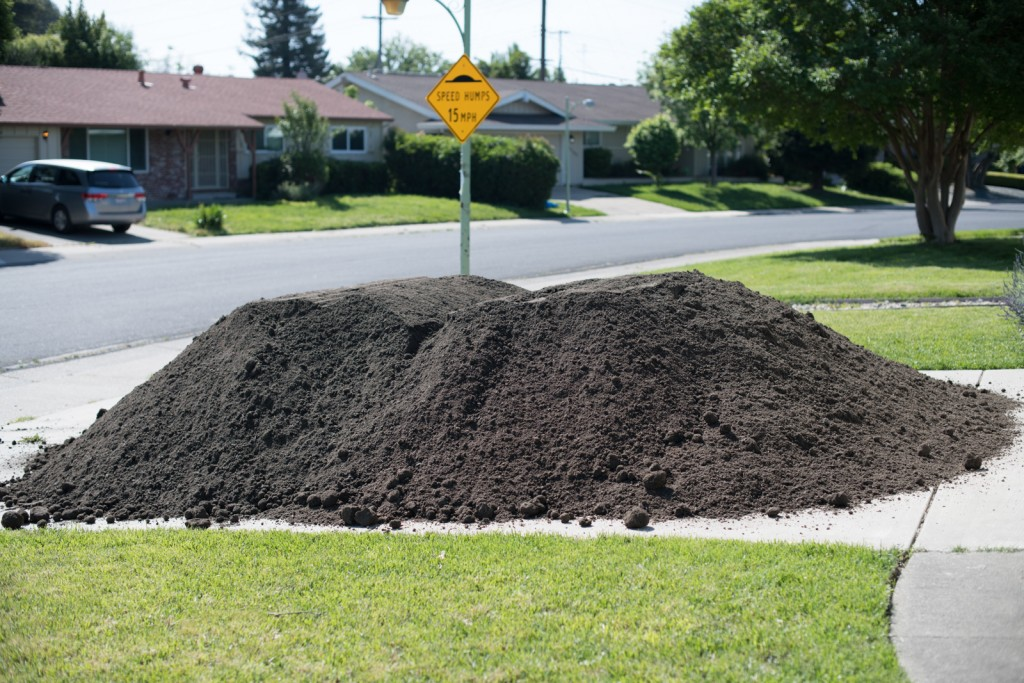 10 cubic yards of lovely dirt humps on my driveway