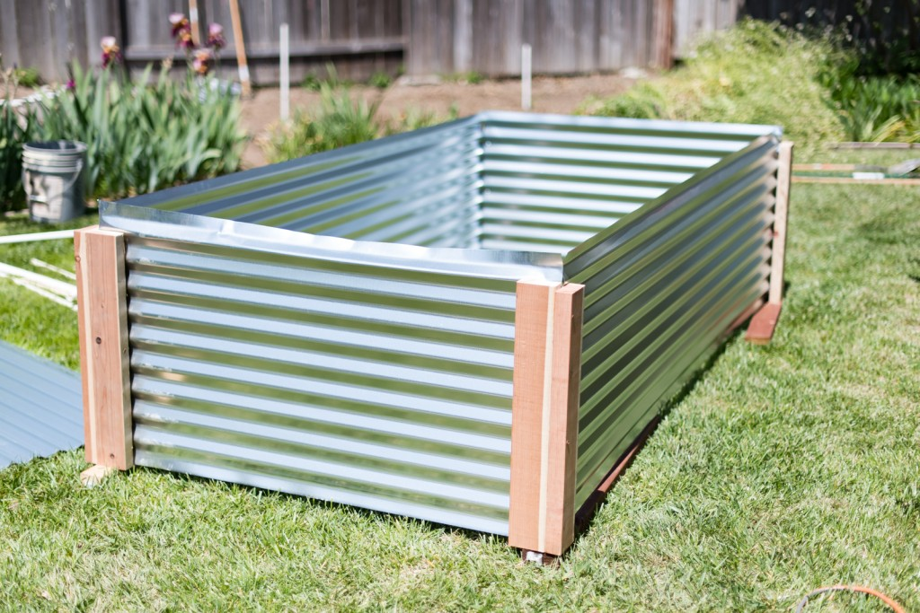 All four sides of the raised metal garden bed screwed together, upside down
