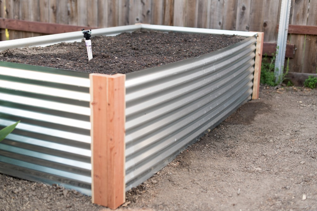 Attaching irrigation valves for each raised metal garden bed