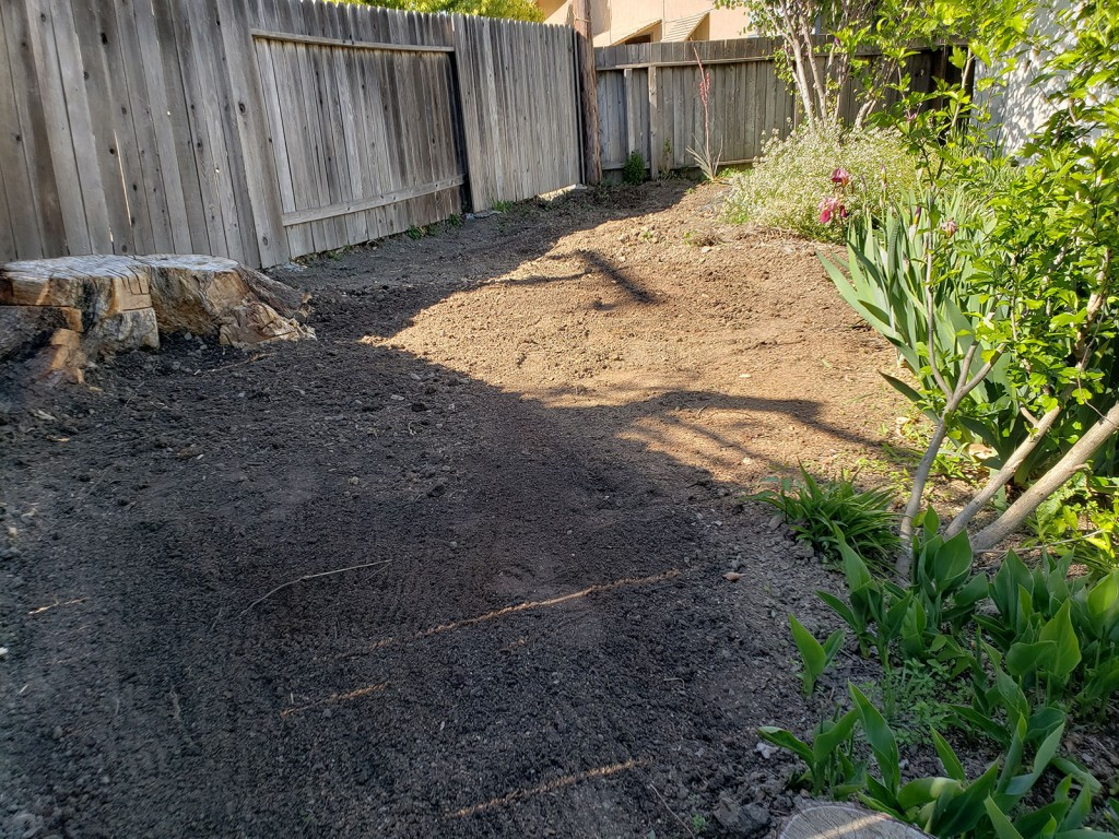 Grading dirt for metal raised garden beds