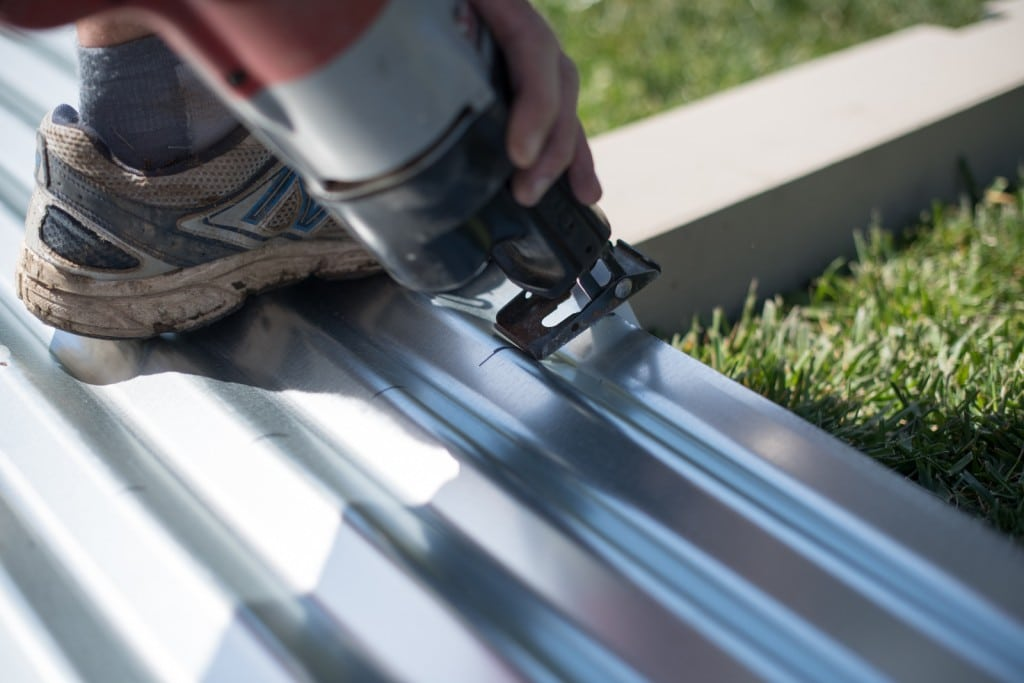Cutting the corrugated metal sheets with a reciprocating saw