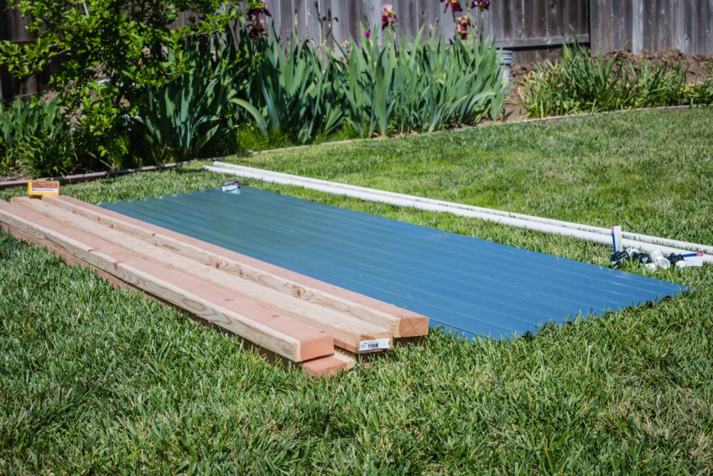 Laying out the supplies for the metal raised garden beds