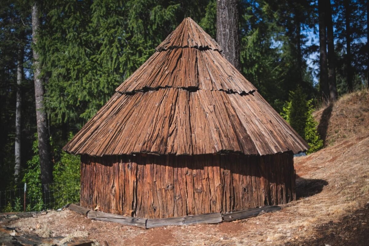 Replica of a traditional Native American hut full of animal hides