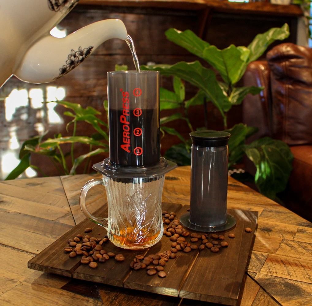 Aeropress coffee maker pouring hot water