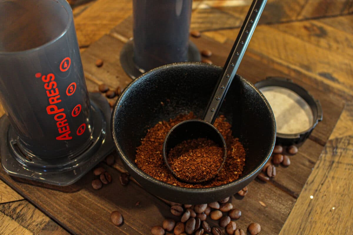 Aeropress coffee maker coffee grounds and scoop