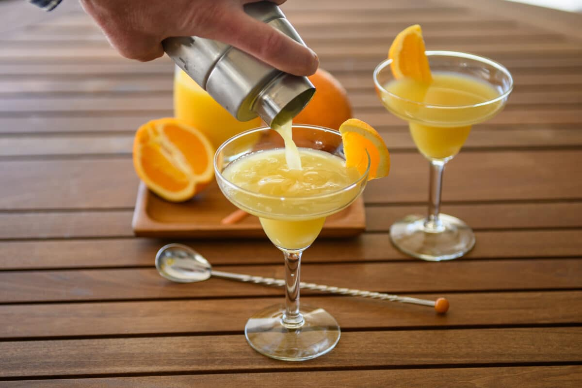orange creamsicle cocktail drink pouring