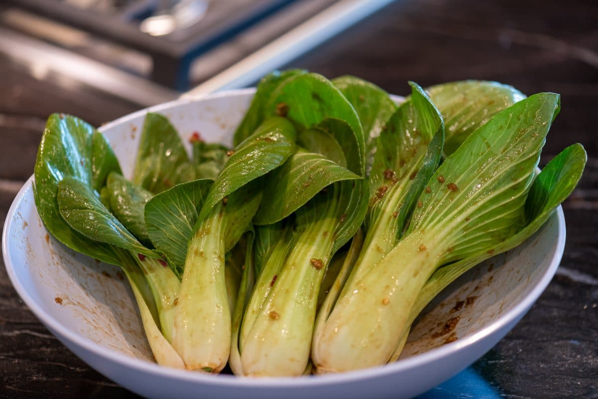 Bok choy coated with marinade