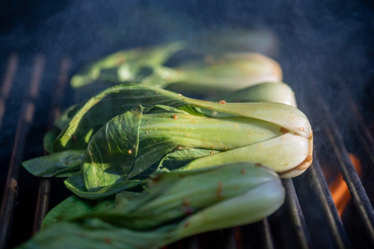 Bok choy cooking on grill