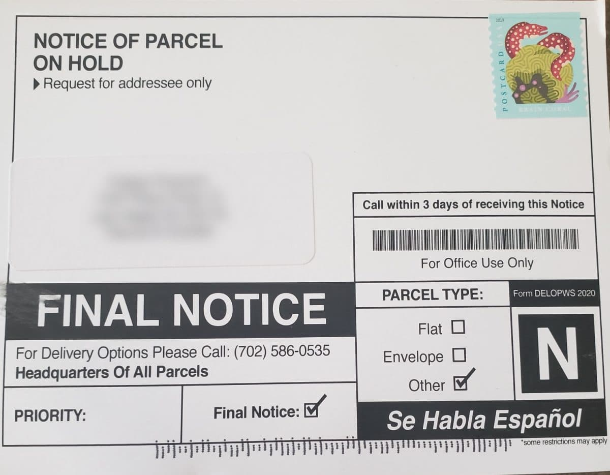 Notice of parcel on hold 702-586-0535