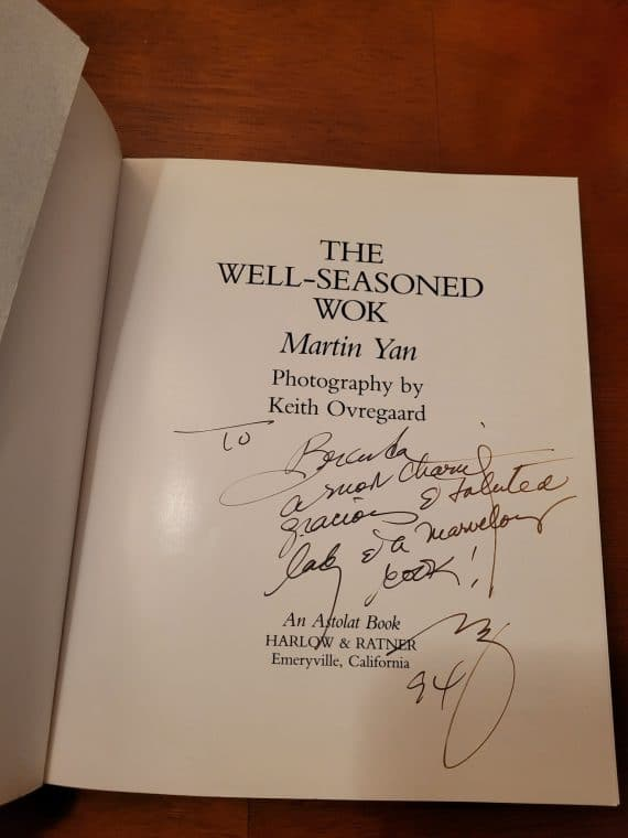 The well-seasoned wok [paperback] [signed] 2 good condition. Some creases on spine. Signed by author martin yan.