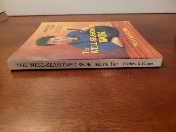 The well-seasoned wok [paperback] [signed] 3 good condition. Some creases on spine. Signed by author martin yan.